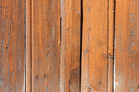 Weathered orange painted pattern wooden wall background photo