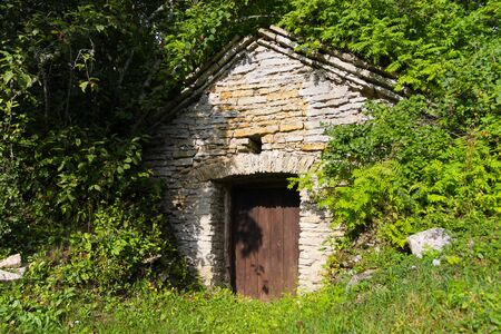Old wooden door of a stone brick barn photo