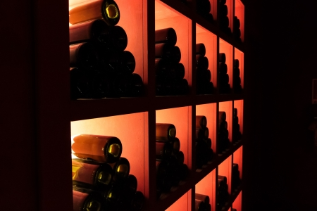 Closeup shot of wineshelf in the dark photo
