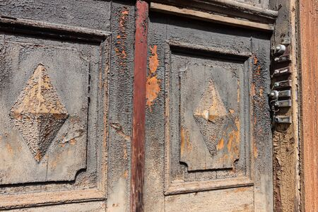 Old-fashioned and damaged grungy door bells photo
