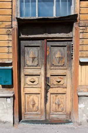 old door and window closeup of wooden building Stock Photo - 14894290