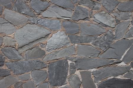Granite flagstone pavement wall background Standard-Bild