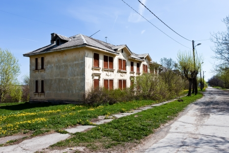 Abandoned house during day with street