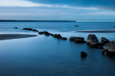 View of a rocky coast in the morning. Long exposure shot. photo