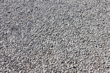Road of small stone gravel texture background photo