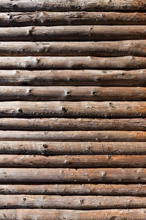 Wooden logs wall of rural house background photo
