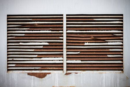 Old metal rusty ventilation windows on wall background Stock Photo - 15219588