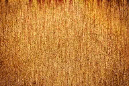 Grunge brown plaster concrete wall wallpaper background photo