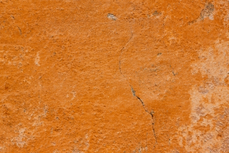 Cracked orange wall wallpaper background Banco de Imagens