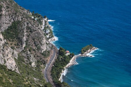 French Riviera with road, turquoise sea and villa from the top of mountain. France, Europe photo