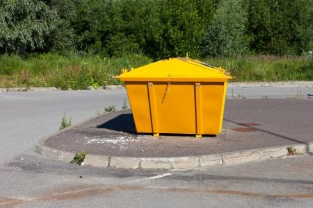 consummation: urban trash yellow industrial waste bin