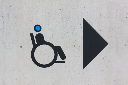 Disability sign on grunge background photo