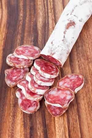 salami sausage on wooden board background photo