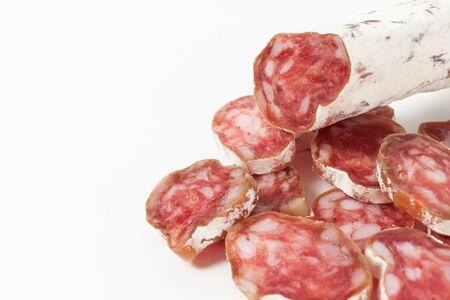 embutido: Salami sliced on the white background Stock Photo
