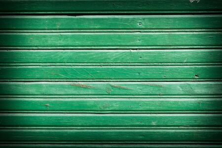 Green old painted wooden background photo