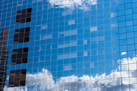 reflecting sky in glass of office building ; abstract background Stock Photo - 15035091