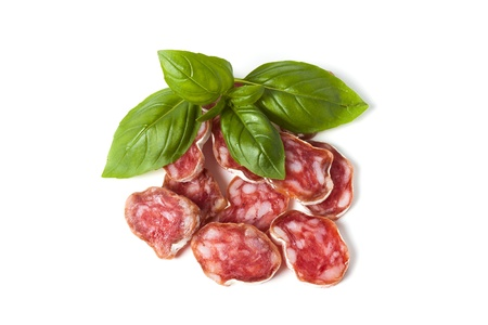 Salami isolated with herb basil photo