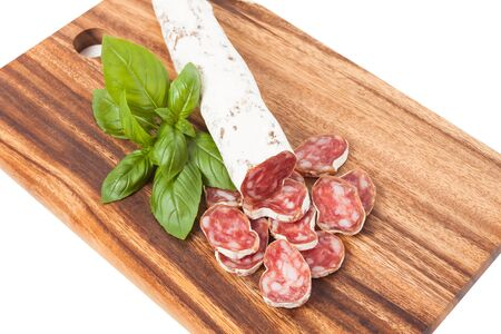 Culinary traditional spanish sausages with peppercorns on wooden textured background photo