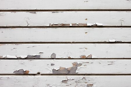Old weathered white wood wall background photo