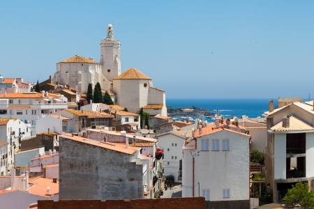 Panorama of white village houses and church tower in Cadaques, Spain photo