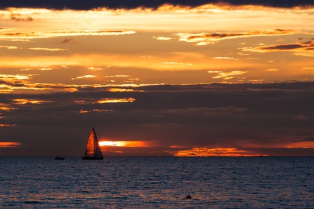Sailing boat silhouette at sunset in sea with cloudy sky Stock Photo - 15805084