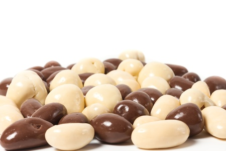chocolate cereal: almonds in chocolate over white background