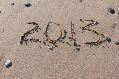 Numbers 2013 on the beach sand photo
