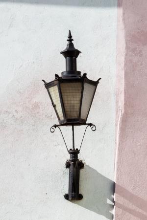 tallin: old lantern on wall in street of Tallin old town, Estonia