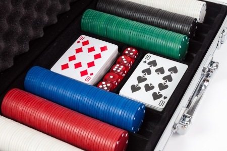 Poker set in metal suitcase isolated on white photo