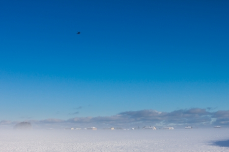 winter foggy landscape with helicopter in the sky Stock Photo - 16513641