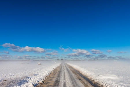 snowy road in coutryside with fogy horizon Stock Photo - 16582495