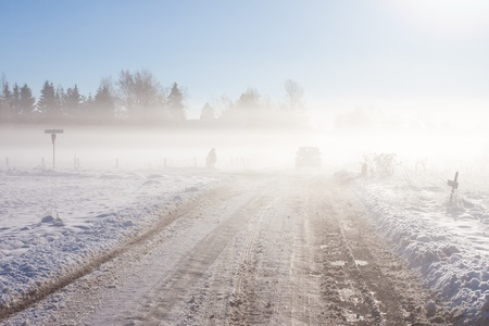 Winter farm road with off-road car and snow Stock Photo - 16630655