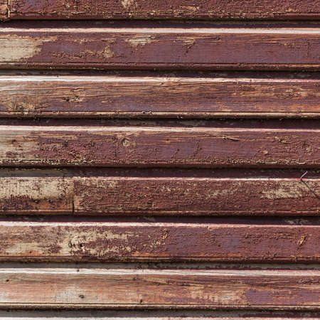 old wooden plank wall of a house. Square format photo