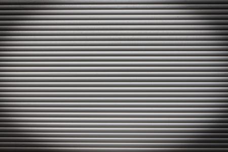dirty metal roller shutter door as a background photo