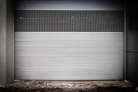 Building with metal roller shutter door photo