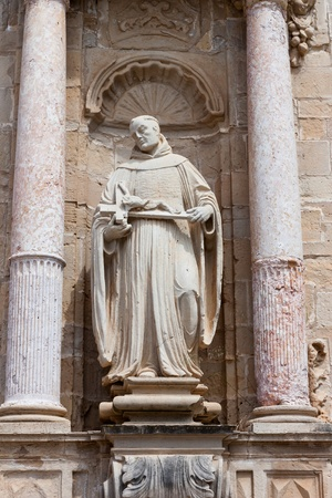 Statue in Real Monasterio de Santa Maria de Poblet  doorway, Spain photo