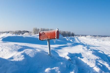 winter frozen mail box under snow