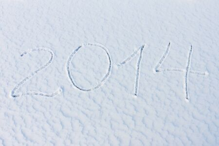 2014 on the white snow for christmas and the new year photo