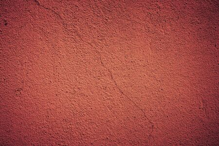 cracked wall red background texture photo