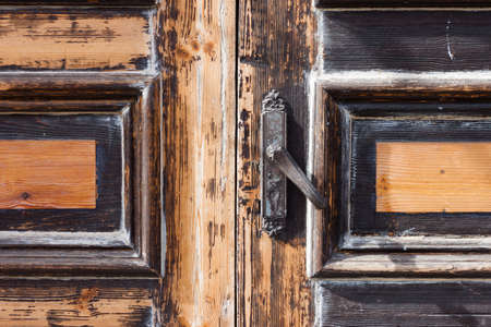 door handles of input,closed and locked old wooden door Stock Photo - 19141644