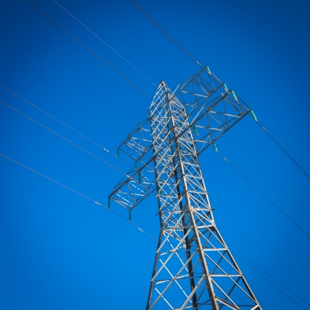 a long line of electrical transmission towers carrying high voltage lines photo