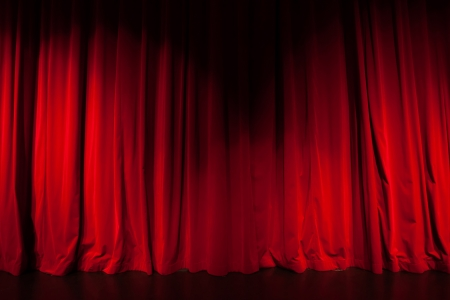 Curtain from the theatre with a spotlight as background