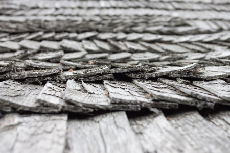 old worn wooden shingle roof pattern - close up photo