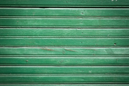 Green paint old wooden plank wall of a house photo