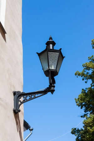lamplight: Old-fashioned lantern on the wall