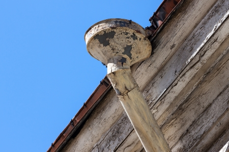 Rain gutters on old home. There is a blue sky in the background. photo