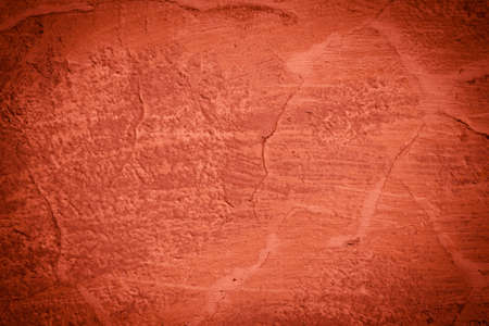 Red background wall texture - cracked and dark edges photo