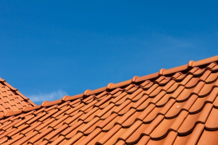 roofing: roof tile pattern, close up  Over blue sky