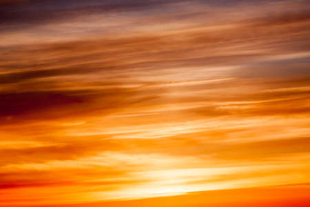 Bright vibrant orange and yellow colors sunset sky photo