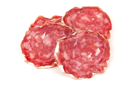 pile of salchichon, red spanish salami, isolated on a white background photo